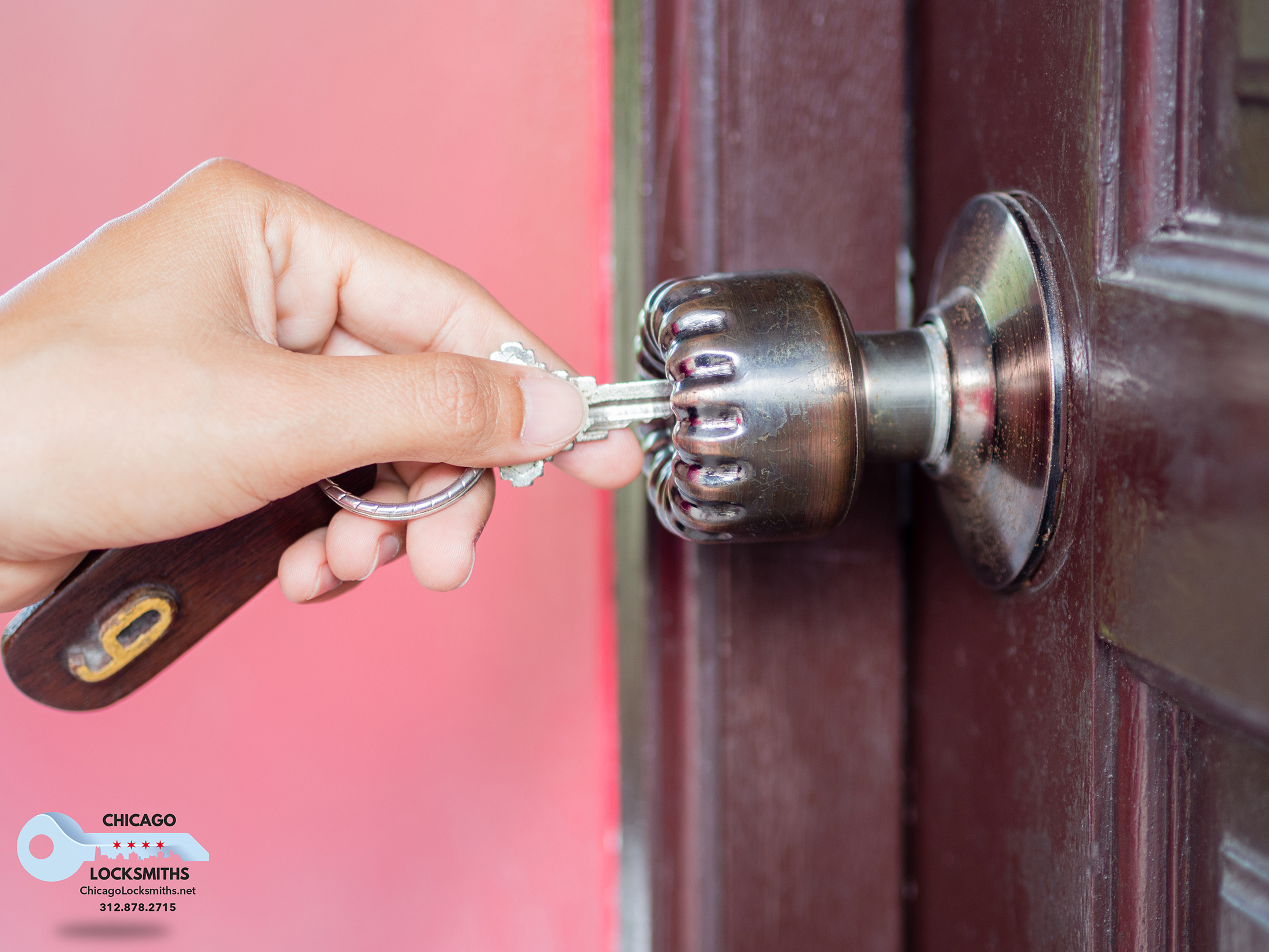 Closeup women is opening the brown wooden door by turning the key in her hand.